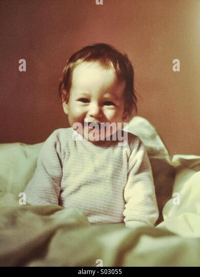 Happy baby, aged 6-9 months - Stock Image
