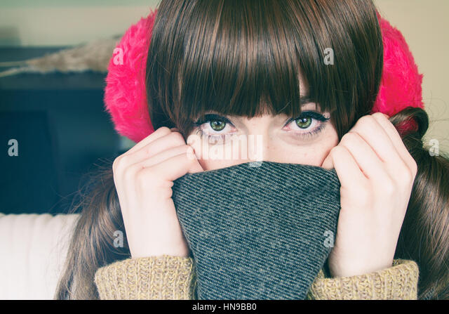 Portrait of a beautiful young woman with winter clothes - Stock Image