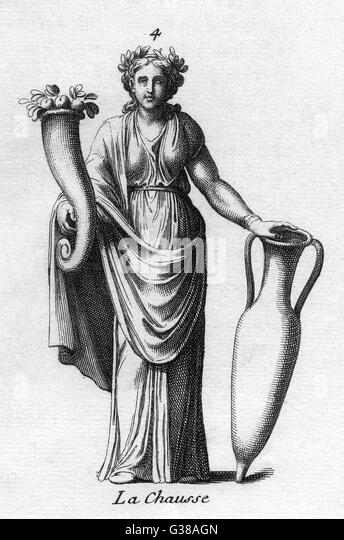A goddess of antiquity -  probably Demeter / Ceres,  carries a cornucopia and an  amphora to signify abundance - Stock-Bilder