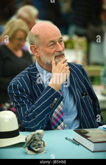 Raymond Tallis doctor, philosopher & author signing books for fans in the bookshop at Hay Festival of Literature - Stock Image