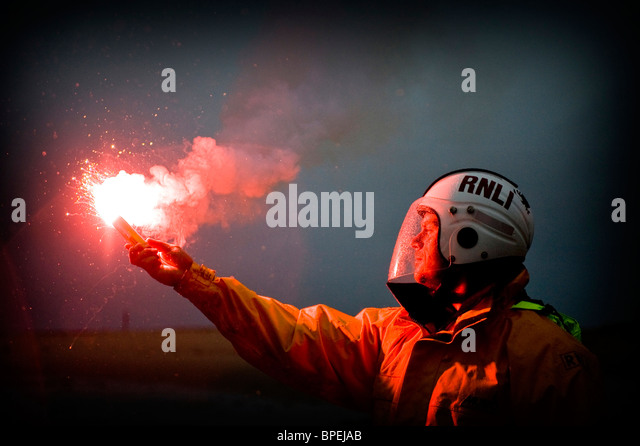 Lifeboat member with flare, Aberdovey, Gwynedd RNLI Aberdovey and Barmouth Lifeboats on Exercise, Gwynedd North - Stock Image