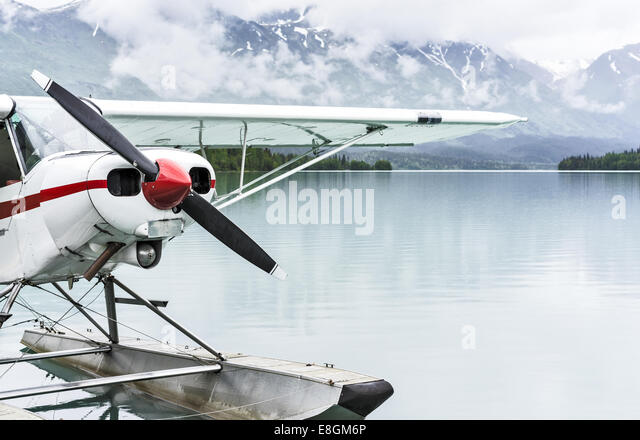 USA, Alaska, Kenai, Moose Pass, Float plane at dock on lake - Stock Image