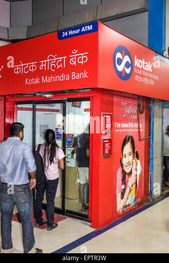 India Asian Mumbai Churchgate Railway Station Western Line train public transportation 24 hour ATM Kotak Mahindra - Stock Image
