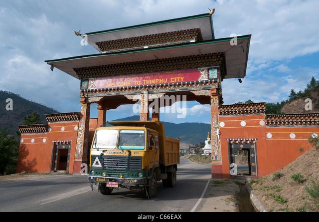 truck driving through welcome road gate to Thimpu. bhutan - Stock Image