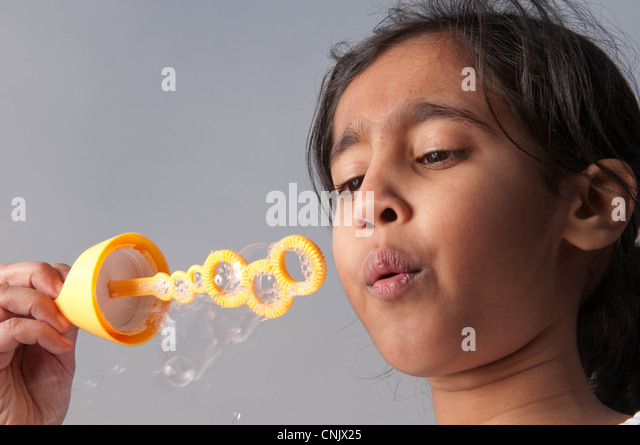 Young girl blowing bubbles - Stock-Bilder