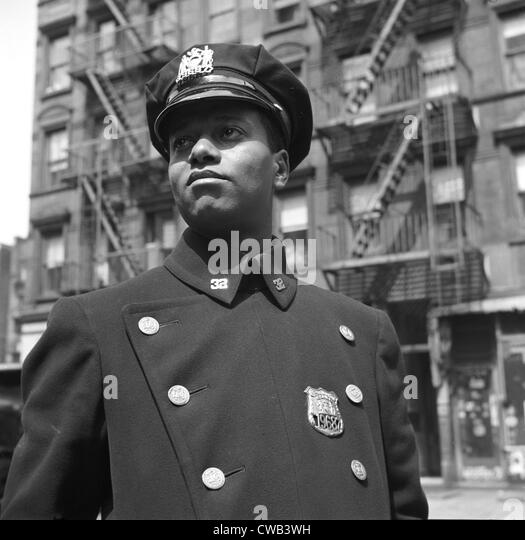 Portrait of an African American policeman, original title: 'New York, New York. Policeman no. 19687', photograph - Stock Image