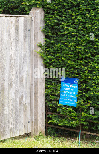 Thieves beware police bait equipment is used in this area sign at Chichester, West Sussex in July - Stock Image