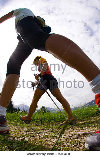 Worm's eye view of a Nordic couple on a walking trip - Stock Image