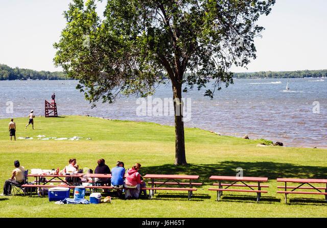 Wisconsin Kenosha Silver Lake Silver Lake Park picnic bench man men woman women boy girl child family summer vacation - Stock Image