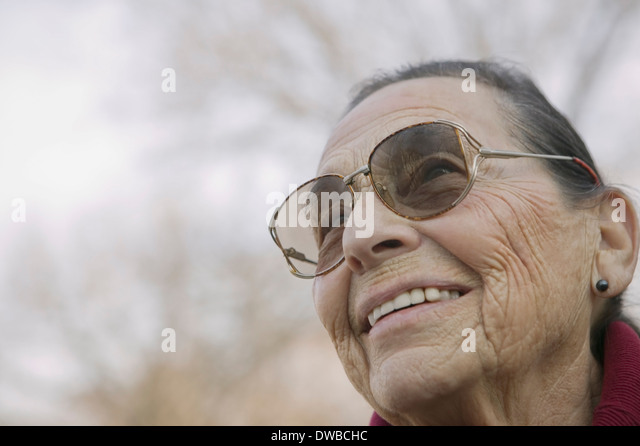 Portrait of senior woman wearing eyeglasses - Stock Image