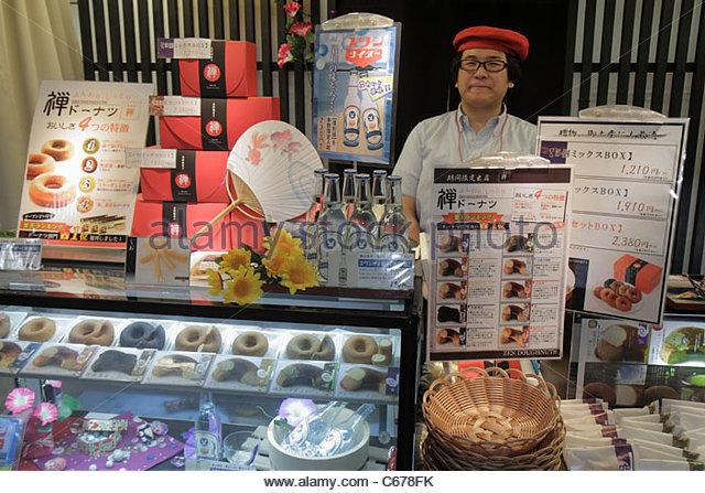 Tokyo Japan Ikebukuro Ikebukuro Station business kanji hiragana characters Asian man manager owner donuts doughnuts - Stock Image