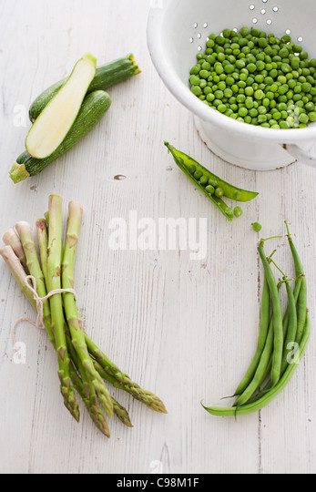 Green vegetables with peas, courgette, asparagus and green beans - Stock Image