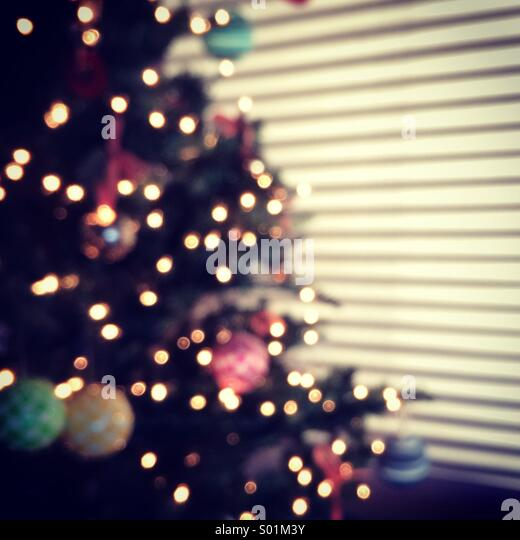 Christmas tree, ornaments and morning shadows - Stock Image