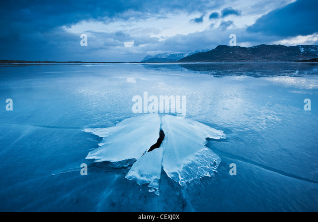 Ice formation of frozen coast of Ytterpollen, Lofoten Islands, Norway - Stock-Bilder