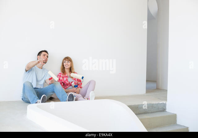 Couple getting ready to paint - Stock Image