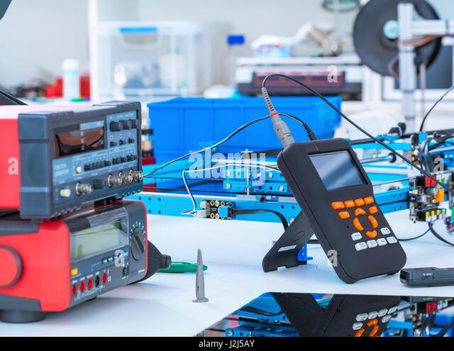Electronics laboratory equipment and machinery. - Stock Image