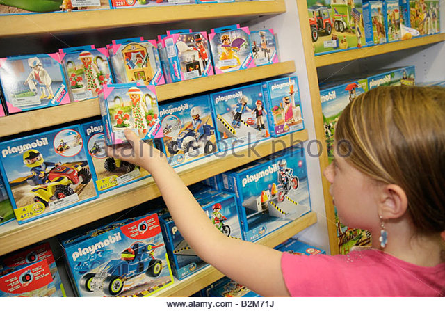 Michigan Traverse City Front Street Toy Harbor shopping girl merchandise display educational learn plastic figures - Stock Image