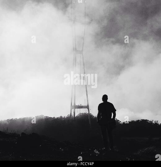 Man Standing Among Smoke - Stock Image