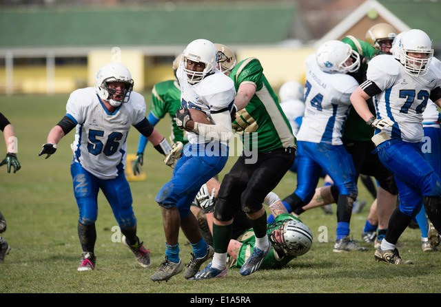 Tarannau, Aberystwyth University american football team (in white) playing a league game Wales UK - Stock Image
