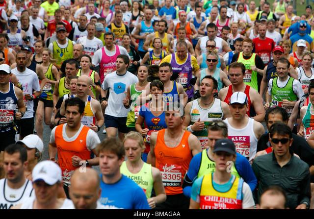 London Marathon runners running along Charlton Way, Blackheath, London, UK - Stock Image
