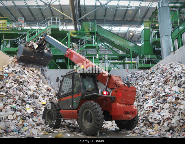 Digger Sorting Recycled Paper - Stock Image