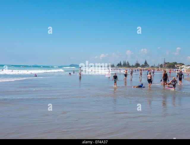 Swimmers on Waihi Beach near Katikati, Bay of Plenty, New Zealand - Stock Image