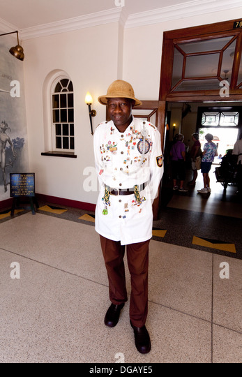 Duly, the doorman at the Victoria Falls hotel, Zimbabwe, Africa - Stock Image