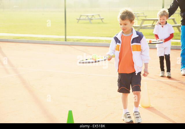 Children Practicing Tennis - Stock Image