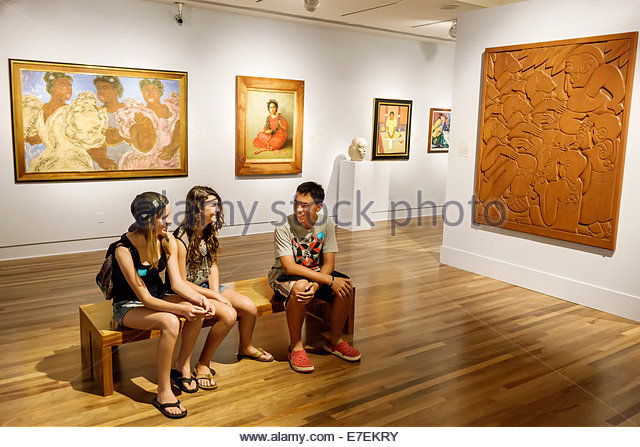 Hawaii Hawaiian Honolulu Museum of Art inside interior paintings gallery teen Asian boy girl friends - Stock Image