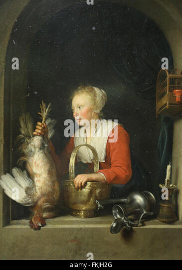 Gerad Dou (1613-1675). Dutch painter. Woman hanging a rooster in her windows or Dutch housewife 1650. Louvre Museum. - Stock Image