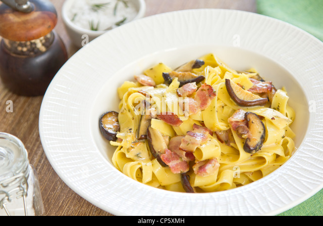 Fettuccine Carbonara with bacon and mushroom - Stock Image
