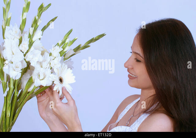 Christen lady looking at flowers MR#733C - Stock-Bilder