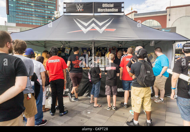 Wrestling fans buy souvenirs and other memorabilia prior to the WWE SummerSlam event at the Barclays Center in Brooklyn - Stock Image
