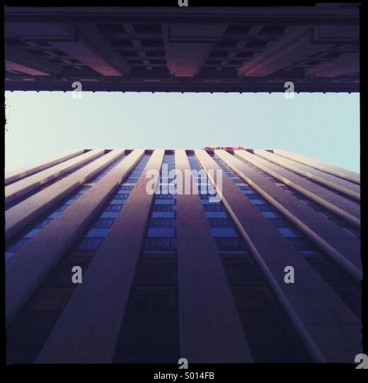 Looking up between buildings towards the sky - Stock Image