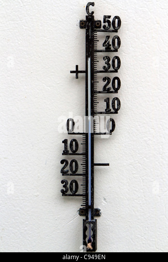 Thermometer screwed to the outside wall of the MS Nordkapp showing a temperature just above 5 degrees centigrade - Stock Image