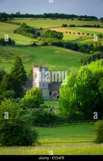 View over 15th Century St Andrew's Church, Naunton, Gloucestershire, England - Stock Image