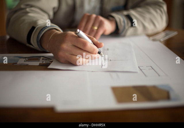 Mid-section of man doing technical drawing - Stock-Bilder