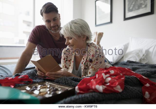 Romantic couple opening Valentine - Stock Image
