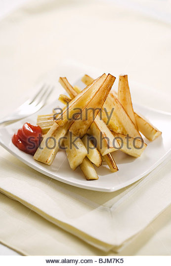 Parsnip Fries on a Plate with Ketchup - Stock Image