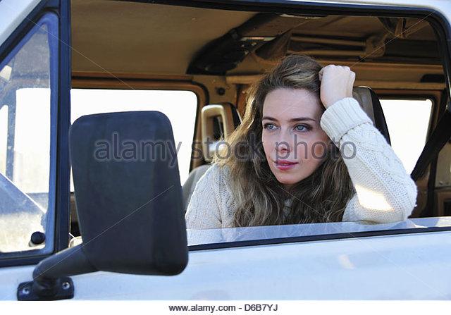Woman sitting in van - Stock Image