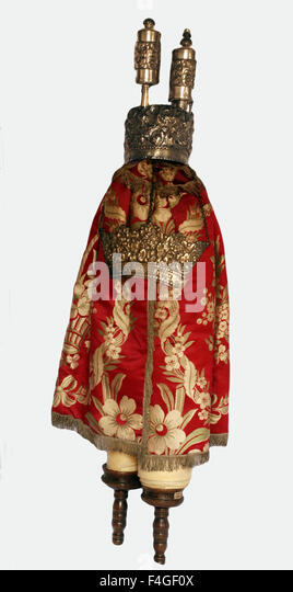 5627.The Torah Scroll wrapped in it's 'coat' decorated with the crown, finials and shield. Northern - Stock Image