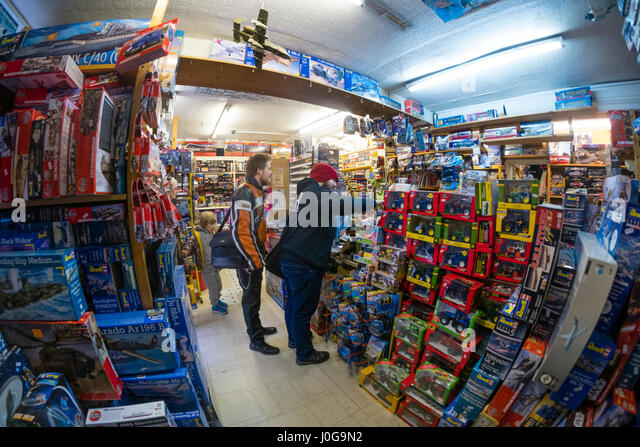 Customers buying model toys in  'The Albatross' traditional old-fashioned  toy, hobby  and model shop, Aberystwyth - Stock Image