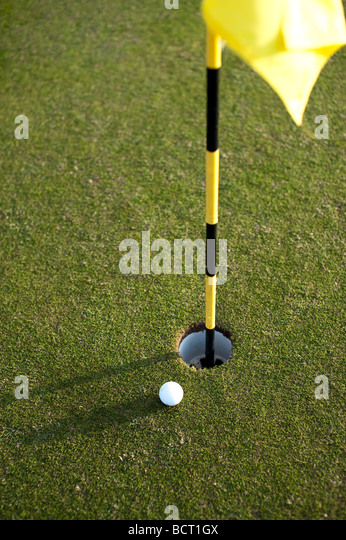 Golf course, flags and balls - Stock Image