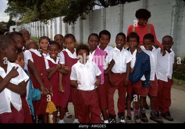 Belize Central America Belize City Central Christian School students uniforms class trip teacher - Stock Image