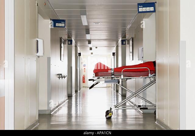Patient left in a hospital corridor - Stock Image