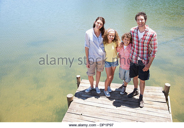 Family standing on dock - Stock Image