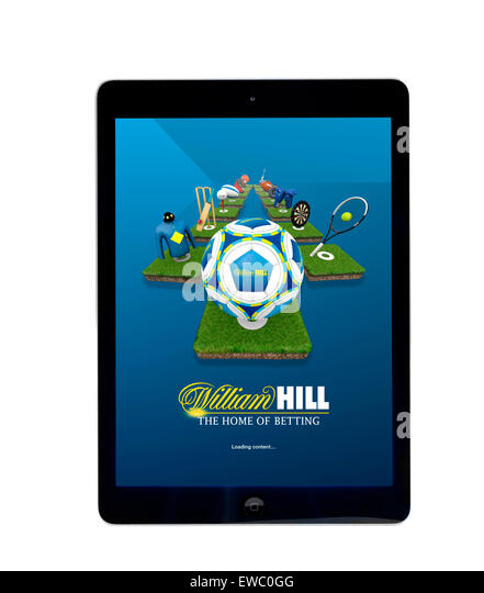 Online betting with the William Hill app on an Apple iPad Air tablet computer - Stock Image