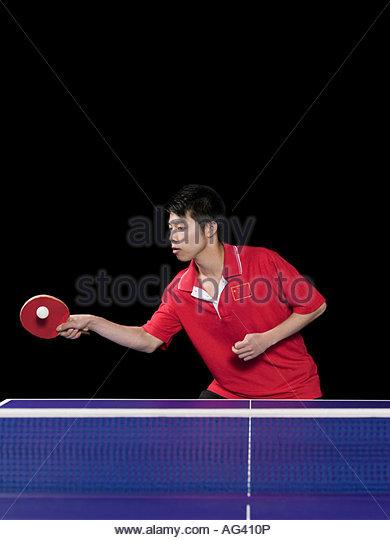 Man playing table tennis - Stock Image
