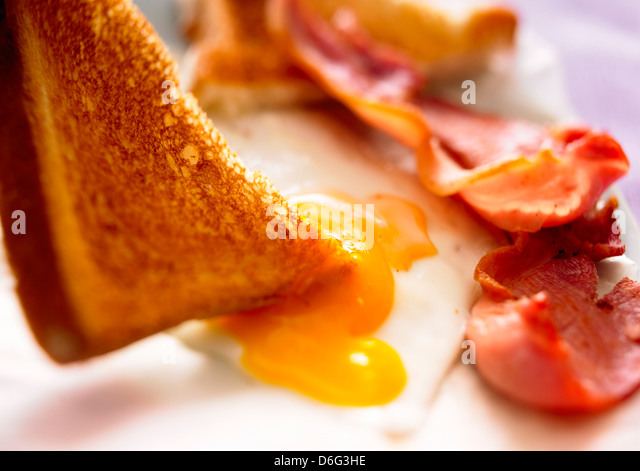 Egg and bacon with toast - Stock Image