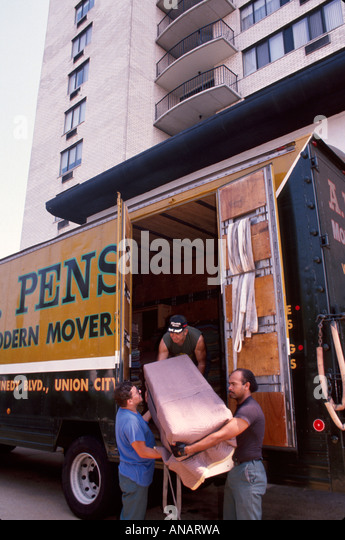 New Jersey Hackensack moving van workers lifting Black male - Stock Image